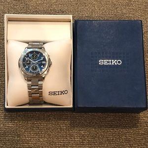 Seiko Men's silver blue face Watch